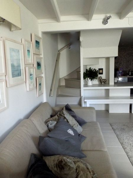 Original wooden floorboards ,exposed granite, artwork and bespoke fitted furniture create a spacious open plan living area. : Holiday Cottage to Rent in St Ives Cornwall : Of Special Interest