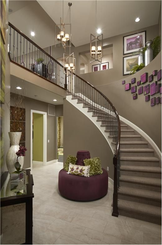 Curved Staircase In The Sterling II. Living Room Wall ...