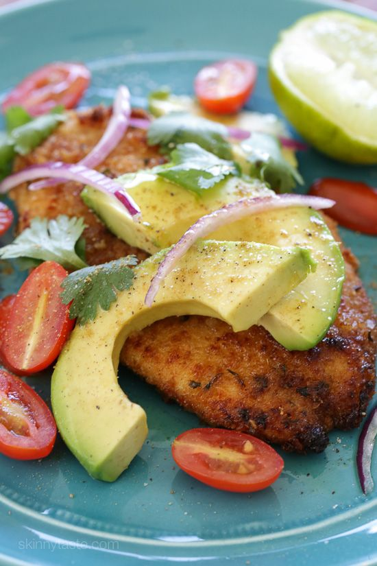 Breaded chicken cutlets cooked in a skillet topped with everything I normally add to my guacamole – sliced avocado, tomatoes, cilantro, red onion and lime juice.