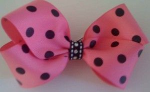 How to Make a Boutique Style Hair Bow - Not having been a huge girly-girl myself, I just know when I have a daughter she will be all ribbons and lace.  When that day comes, I will make her these.