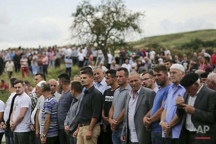 People attend the funeral ceremony for Diamant Zabergja, 21, one of the victims of the Olympia shopping centre in Munich, in the village of Ropice, Kosovo, Tuesday, July 26, 2016. Three ethnic Albanians, two women and a man, were among the nine people killed by a gunman in Munich four days ago. (AP Photo/Visar Kryeziu)