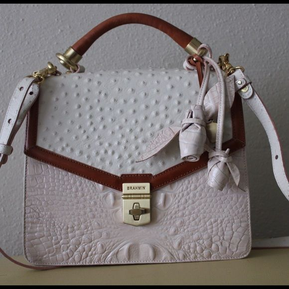 Sale This Weekend Only 20% OffBrahmin Handbag Gently used, very good condition! Only ware is the gold latch. Soft white and pink color. Comes with original dust bag. Let me know if you have any questions or would like more pictures. Brahmin Bags Crossbody Bags