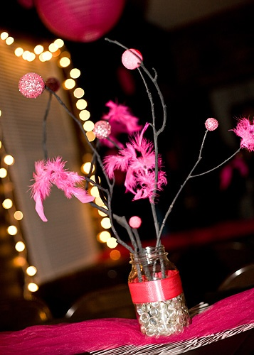 Centerpieces DIY - spray paint branches black, paint foam balls from Dollar tree with pink paint, roll some of them in glitter.  Attach feathers from a Dollar Tree boa to other branches!