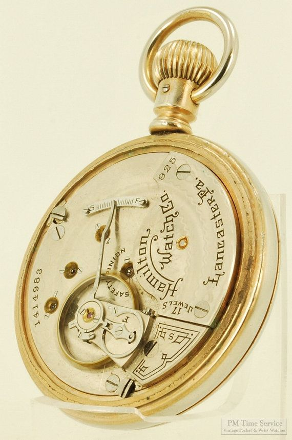 Hamilton grade 925 vintage pocket watch, 16 Size, 17 Jewels, base metal display case with fading yellow gold plated finish (movement view).  $295, on Etsy.