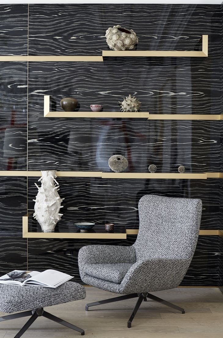 Parisian Apartment by Stéphanie Coutas. Incredible wall patterning - a striking black wall with wood grain patterning.