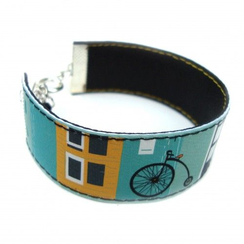 Leather bracelet with unique graphic illustration by Rosehip.  http://caleidostore.com/designers/rosehip/