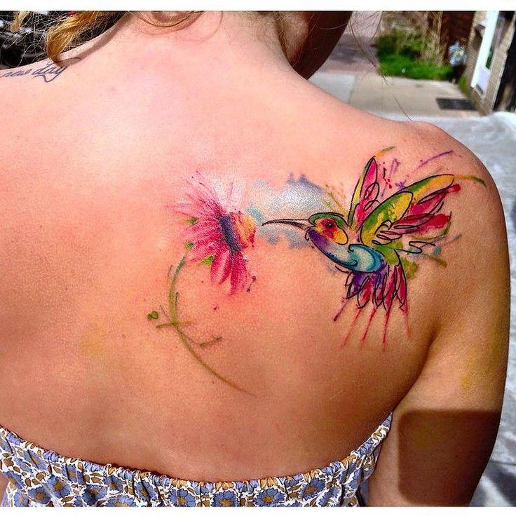 Messy watercolour tattoo of a hummingbird.