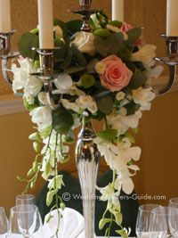 close up of pink roses on a wedding candelabra centerpiece
