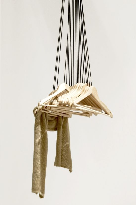 Wood hangers attached to the ceiling. #Style #Modern #Sculpture