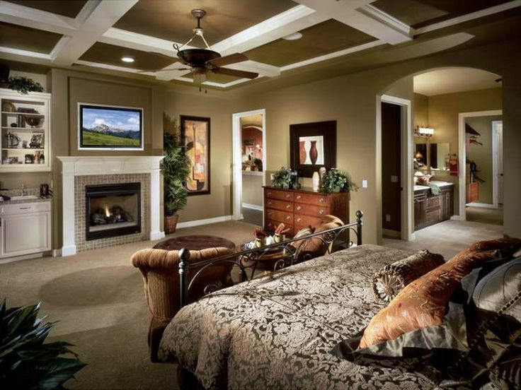 master bedroom with flatscreen tv and fireplace