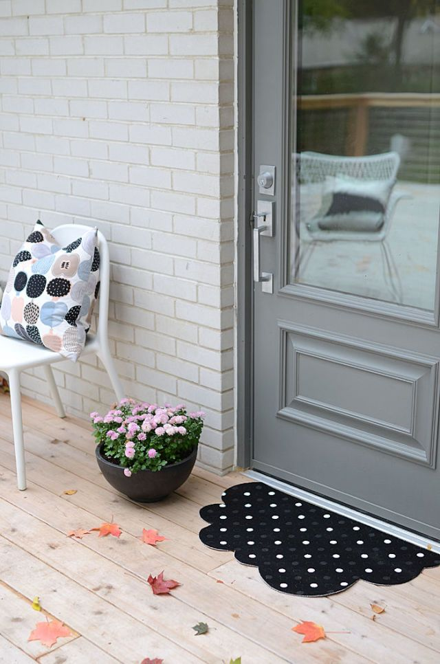 Cut any doormat into a fun cloud shape, and paint with your favorite pattern.