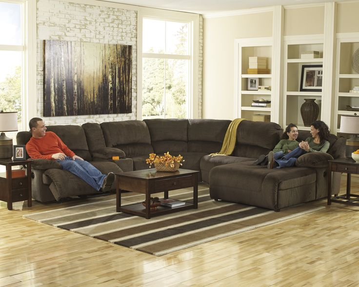 Family night has never felt so good! Quality Bedding and Furniture has unbeatable prices. Only $1,999.00 for this reclining sectional with chaise. #livingroomfurniture #recliners #ashleyfurniture #comfy www.qualitybeddingfurniture.com www.facebook.com/qualitybeddingandfurniture www.twitter.com/QBFOrangePark