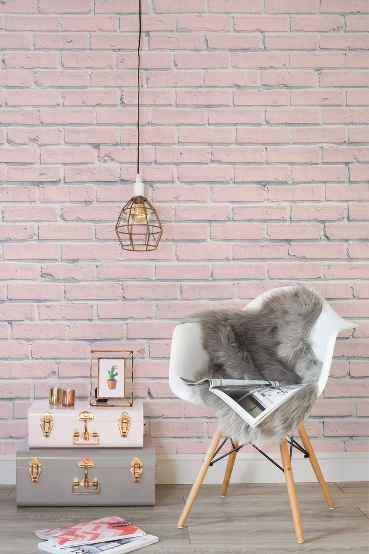 Bring some rustic chic into your home with this pink brick wallpaper design. It's girly yet versatile, making it a beautiful choice for modern living room or bedroom spaces.