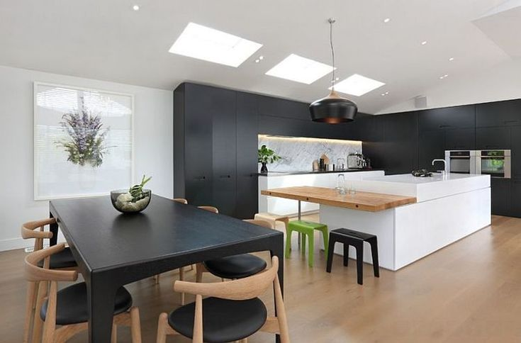 Matt-black-finishes-and-pristine-white-complement-the-warm-wooden-floor.jpg