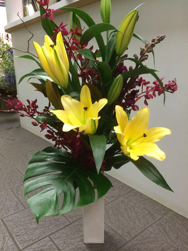 Smaller arrangement.... concador lillies, red James storii