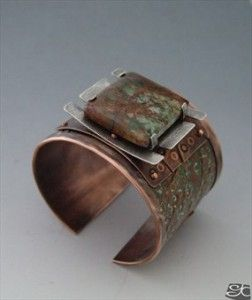Handmade copper and sterling silver cuff bracelet with brown and green patinas ,the focal piece is aturtle set green African opal.