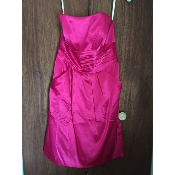 Pink Dress Begonia colored bridesmaid dress. Size 4 with no alterations. Would work as a dress for a school dance or also wedding. Plain enough that you could add anything to it to dress it up or keep it casual. Offers are always welcome :) David's Bridal Dresses Strapless