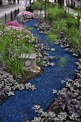 Garden path of blue stone looks like a river, stones for around the pond