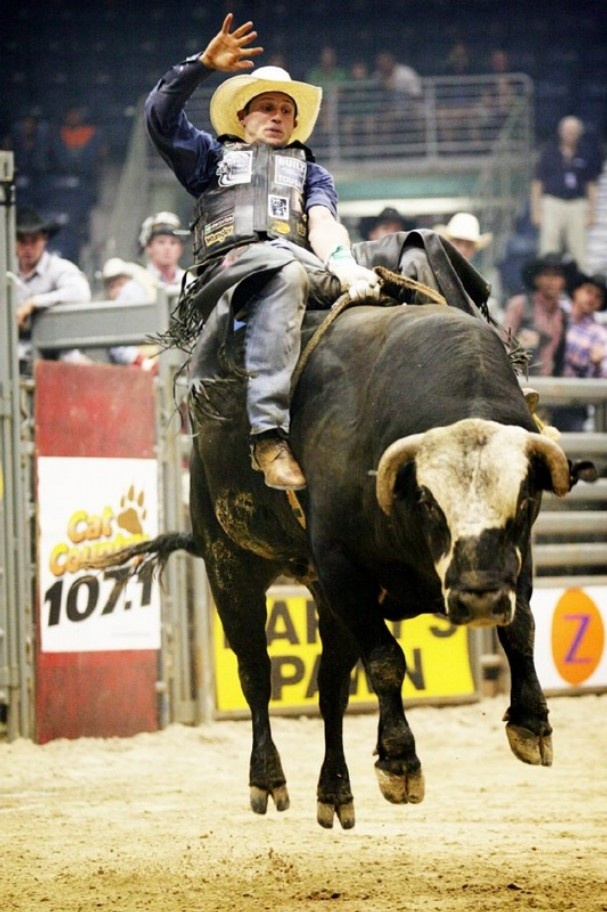 Billy Robinson, of Galax, Va., competes in the PBR bull ...