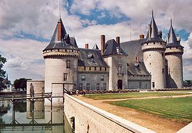 The Château de Sully's ancient towers and donjon are on the right