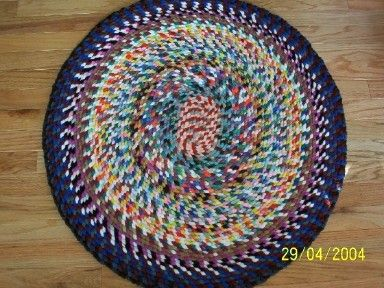 Rug made from spool knit yarn.  My mom would use the yarn from old sweaters.  She would unravel the sweaters, spool knit the yarn & crochet the thick cable into a rug.  (But then again, most of the sweaters had been hand knit with wool yarn!)