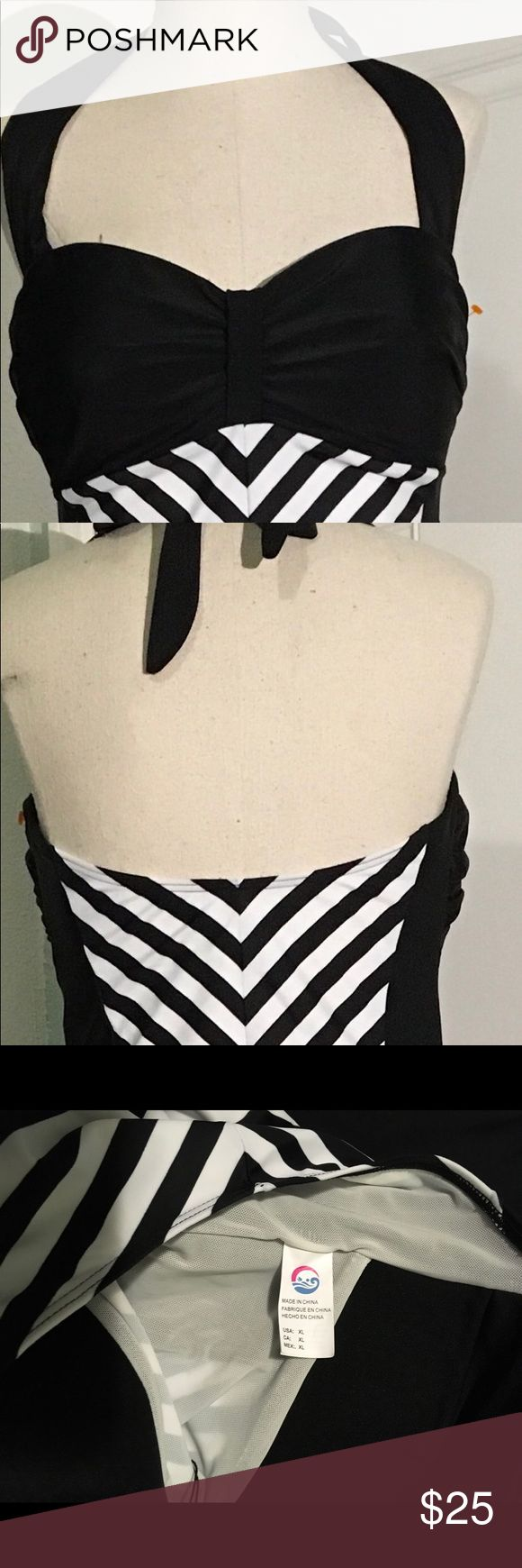 Swim suit Beautiful halter too like swim suit in multi color, it's solid black with black solid lines mixin Swim One Pieces