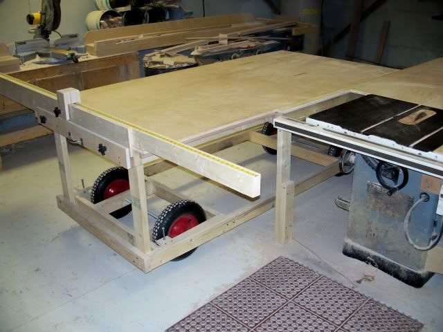 Shop-Built Sliding Table Saw.  The 2 x 4 construction and wheelbarrow wheels do not inspire confidence, but the design is actually not too bad.