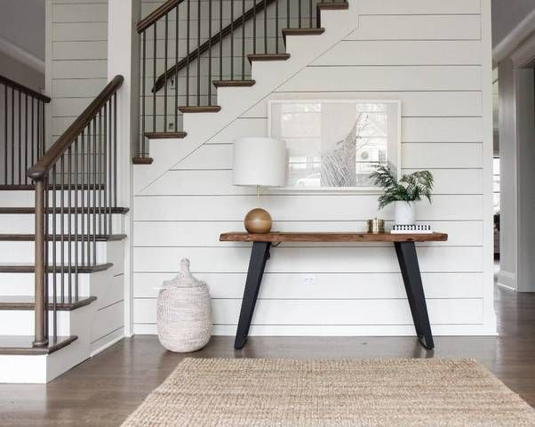 farmhouse interior white staircase with console table