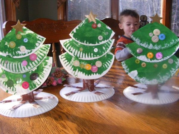 Cut 2 paper plates into 3 triangular pieces and paint green. Paint a paper towel roll brown. Cut slits in it about 1/3 of the way up on one end. Spread and tape to another paper plate. Glue tree pieces together and decorate with button,gems,sequins or paper dots. Add a star at the top and glue onto the paper towel roll. by nadine