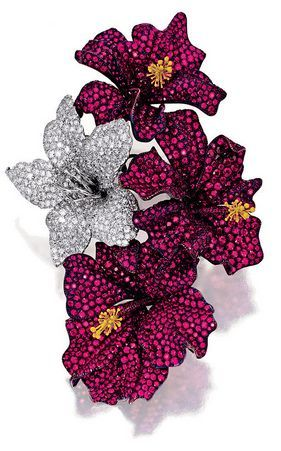 RUBY AND DIAMOND BROOCH, 'HIBISCUS', MICHELE DELLA VALLE Realistically designed as a spray of hibiscus, pavé-set with circular-cut rubies and diamonds, accented with yellow enamel*** pistils, mounted in white gold and titanium, signed Michele della Valle and MdV and numbered, case.