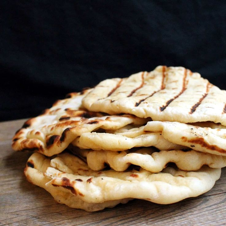 What would a feast of India be without some delicious Naan? We've had our Strawberry Lassis and our to-die-for Chicken Tikka Masala, but let me tell you… the Naan makes the meal. And today I'm especially excited to share my first cooking video. It is nerve wracking to put myself out there like this, but...