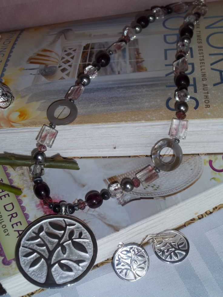 Necklace with tree pendant and matching earrings
