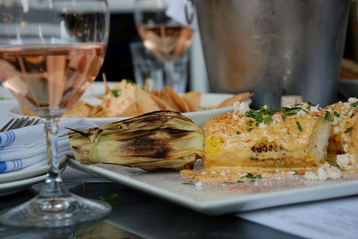 Street corn and rosé are some summer treats at the restaurant at Farmstead.