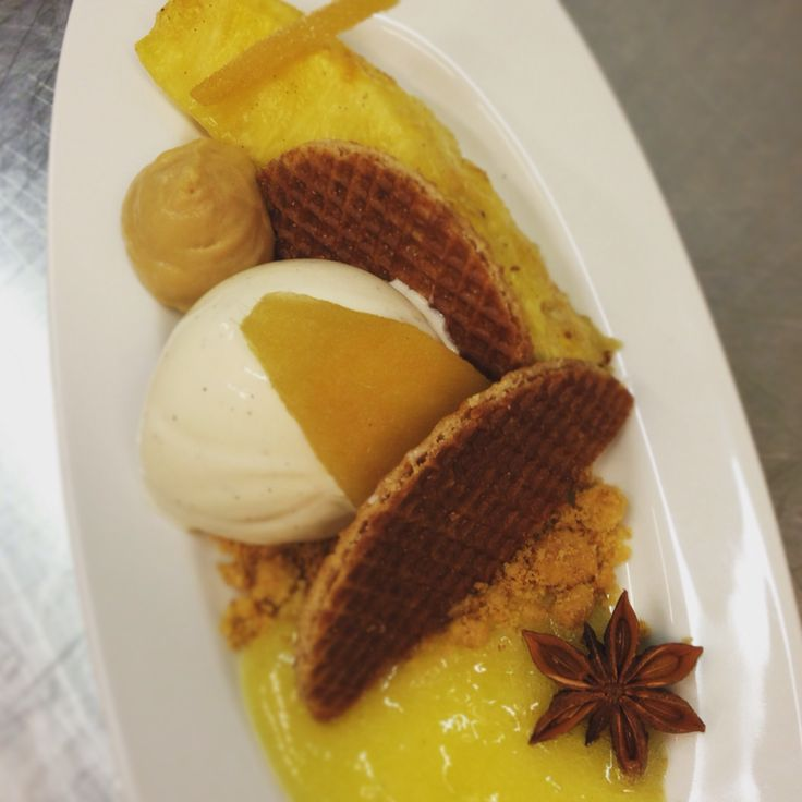 Roasted pineaple dessert! Caramel mousse,caramel waffle,ananas sauce,i/c vanilla,candied ginger,ananas roasted with rum vanilla beans brown sugar and star anise By chef patissier argiris papastavrou