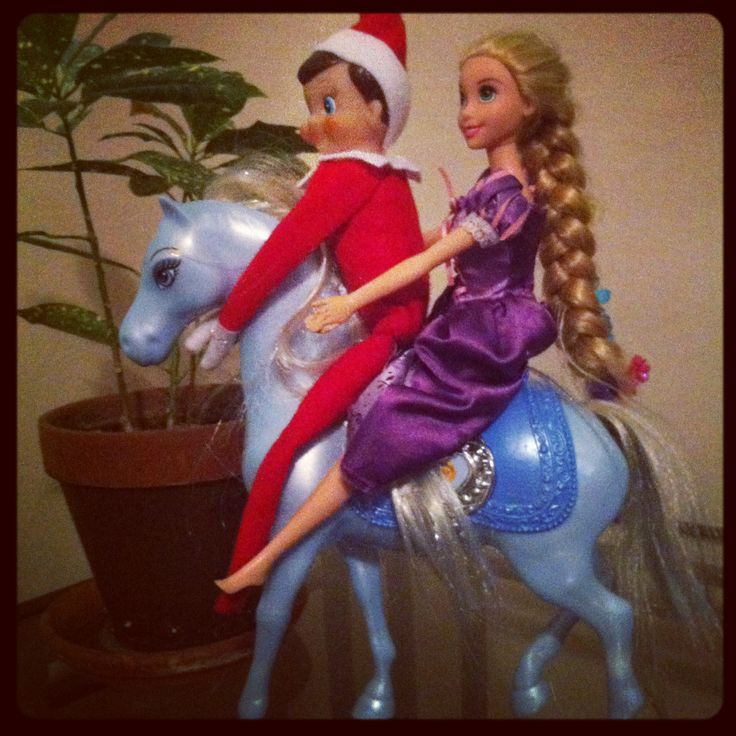 Elf on the Shelf goes on a romantic horseback ride.