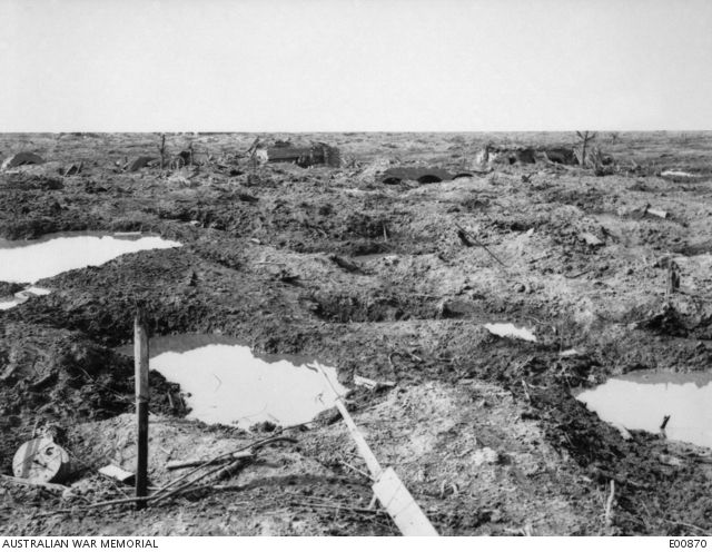 WWI, 1 Oct 1917; View of the battlefield in the Ypres Sector, showing some of the many pillboxes which fortified this area against the Australian attack of 20 September. Note the thickness of the roof of the one in the centre, and the triple arched type a little to the right of it, upon which direct hits from anything less than 9 inch high explosive shells did no material damage. There were probably fare more pill boxes to the acre in this area than on any other part of the Western Front.