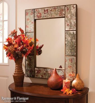 Allow your entryway to make a statement with a large mirror and seasonal decor. You do not need to go over-the-top