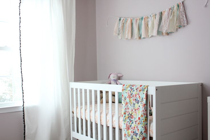A soft and feminine nursery for our second baby girl. I was inspired by busy floral fabrics and muted colors - lavender, peach and aqua.