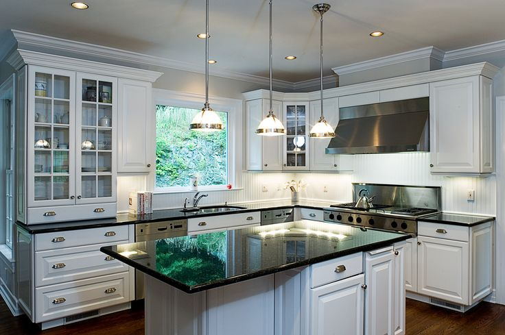 Raised panel white kitchen cabinets with white bead board backslash.