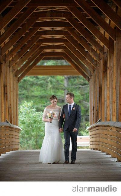 Golden B.C. Wedding, Bride and Groom on Bridge, Kicking Horse Mountain Resort Wedding Photographer