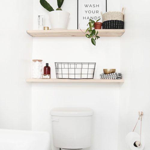 items on wood bathroom shelves above toilet   – bathroom inspo
