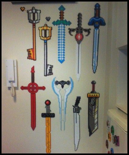All the blades, left - right. Top: Mickeys Keyblade - Kingdom Hearts Kingdom Key - Kingdom Hearts Diamondsword - Minecraft Sword of Omens - Thundercats Mastersword - Legend of Zelda, A Link to the Past  Bottom: Demon Sword  - Adventure Time Golden Sword - Adventure Time Energy Sword - Halo Gunblade - Final Fantasy 8 Buster sword - Final Fantasy 7