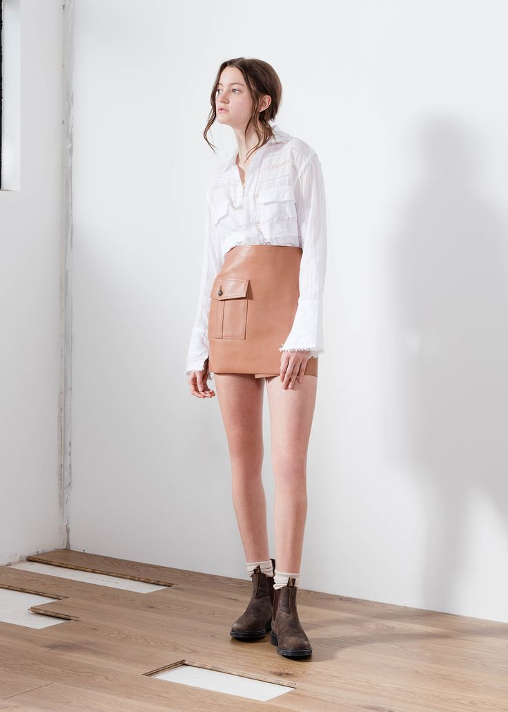 Aje brown leather wrap mini skirt axl.  #AjeTheLabel #Fashion #Style #Lace #BroderieAnglaise #Embroidery #Frill #Sequins #Texture #Exclusive #Summer17 #EdwinaRobinson #AdrianNorris #White #Chambray #Navy #Nautical #LaDolceVita #Travel #Inspiration #