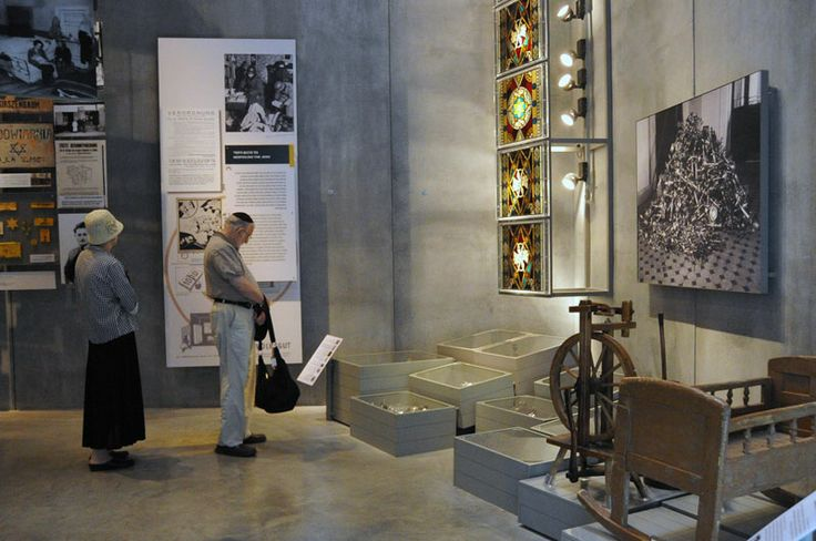 The Holocaust History Museum - The Awful Beginning: The gallery ends with the uprooting of Jews from the general population and into Ghettos.  As visitors leave the gallery they see a wagon, typical of those used by Jews forced out of their homes.