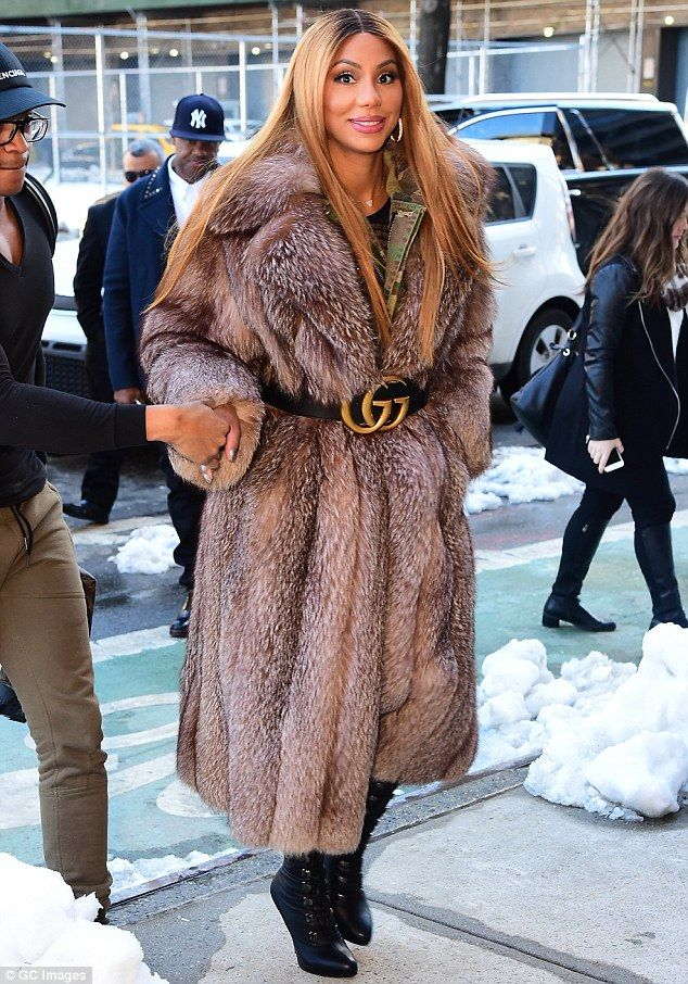 Warm and fuzzy: On Thursday, Tamar Braxton, 39, braved the freezing weather in New York, c...