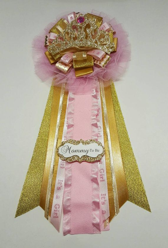 Elegant mommy to be corsage for your pink and gold princess royal baby shower theme. Shimmery gold tiara on a tutu and matching ribbon.