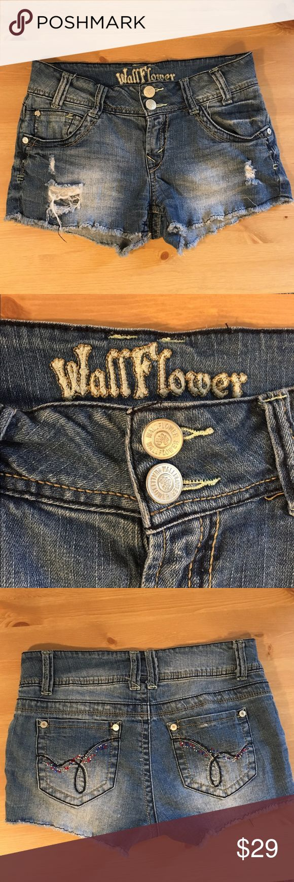 ✨WallFlower Jean Shorts✨ WallFlower jean shorts made of indigo denim with a tint finish, distressed details on the front with red, white, and blue bling details on the back pockets. Size 5 Wallflower Shorts Jean Shorts