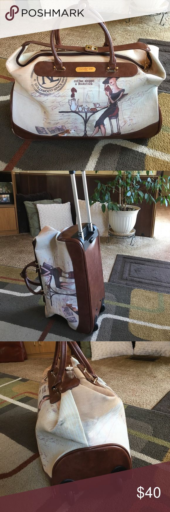 """Nicole Lee travel bag Bag measures approx H 13"""" x W 21.5"""" x D 9""""  bag has extendable handle and wheels on one side bag is used and does have some wear inside one large zip pocket and one velcro closed laptop spot Nicole Lee Bags Travel Bags"""
