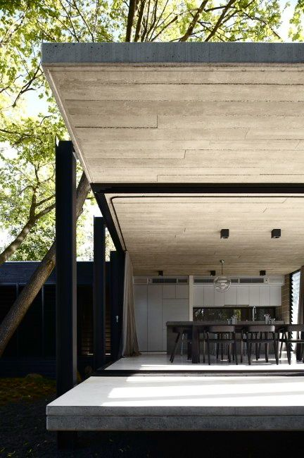 Raw materials: concrete, black wood paneling and steel