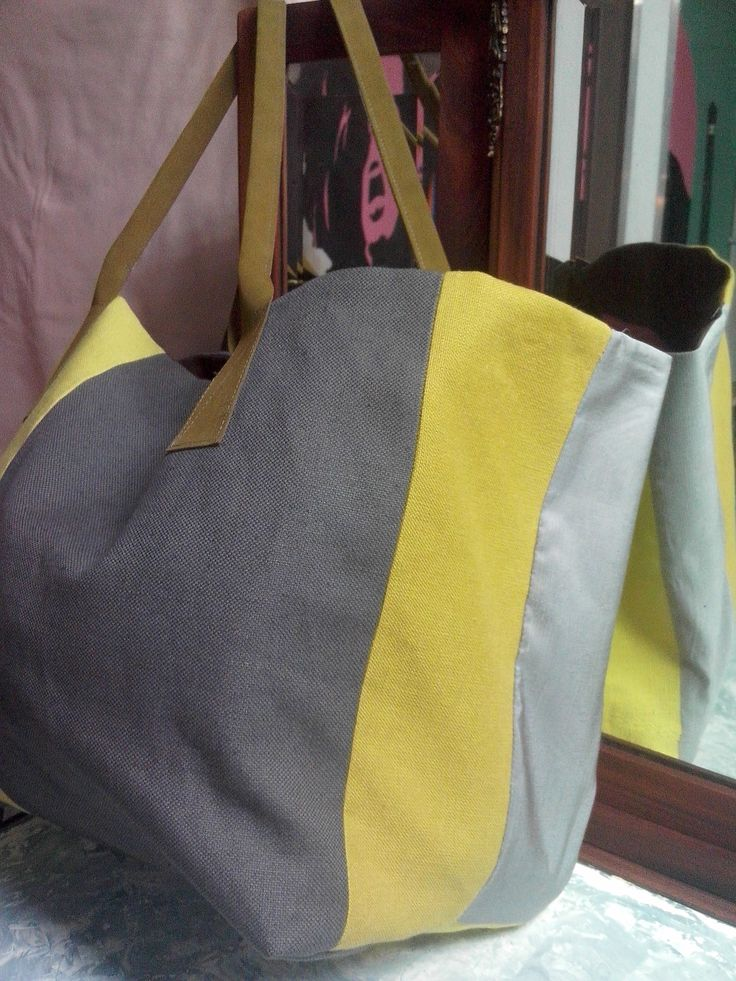 Big size bag with cotton ,silk text from upholstery and leather handle